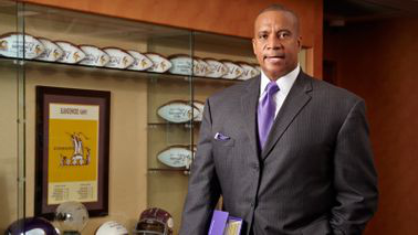 Kevin Warren in his NFL office making history 和 managing the Vikings