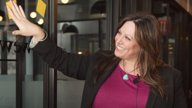Entrepreneur Erica Wexler arranges post-it notes in her office