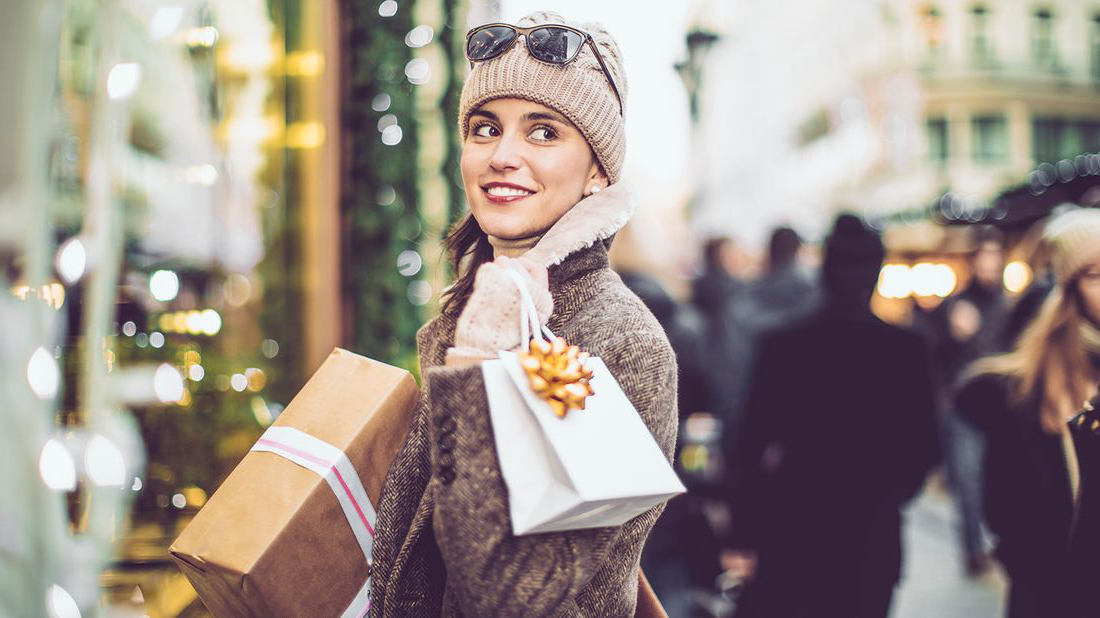 A young woman shopping during the holidays