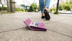 woman leaving wallet on ground