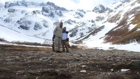 Couple on a glacier as they backpack through South America