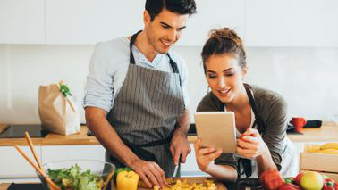 Merging finances with your partner couple in kitchen