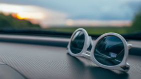 Sunglasses on a car dashboard after the driver hit the open road