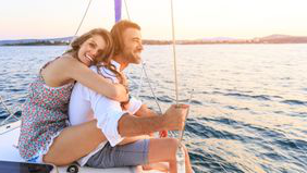 newlywed couple on honeymoon sailing
