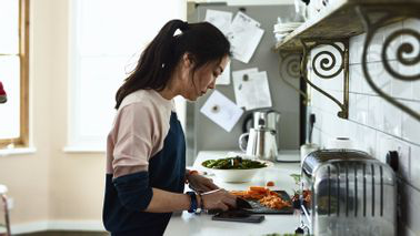A young woman preparing a meal during coronavirus quarantine