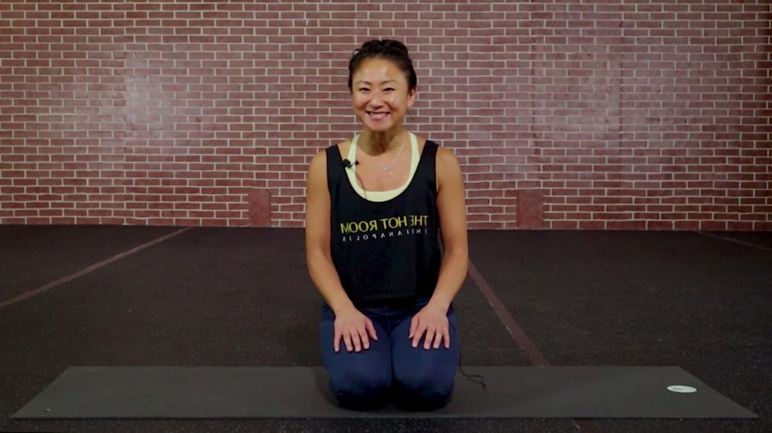 Hye Jin Kalgaonkar of the Hot Room yoga studio teaching online class.