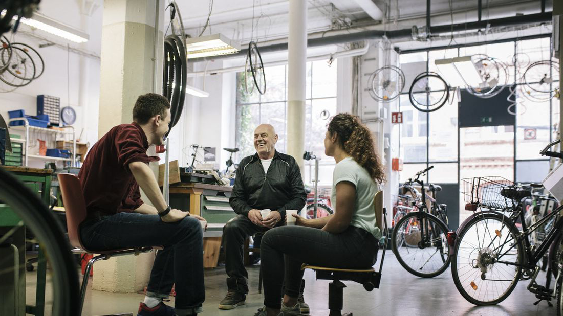 A bike shop owner discusses SECURE Act with employees