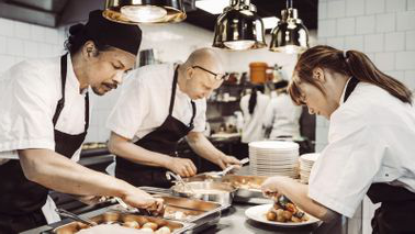Chefs preparing a meal.