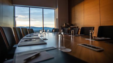 Executive board room overlooking mountains