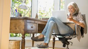 Woman on her computer checking the social security retirement age