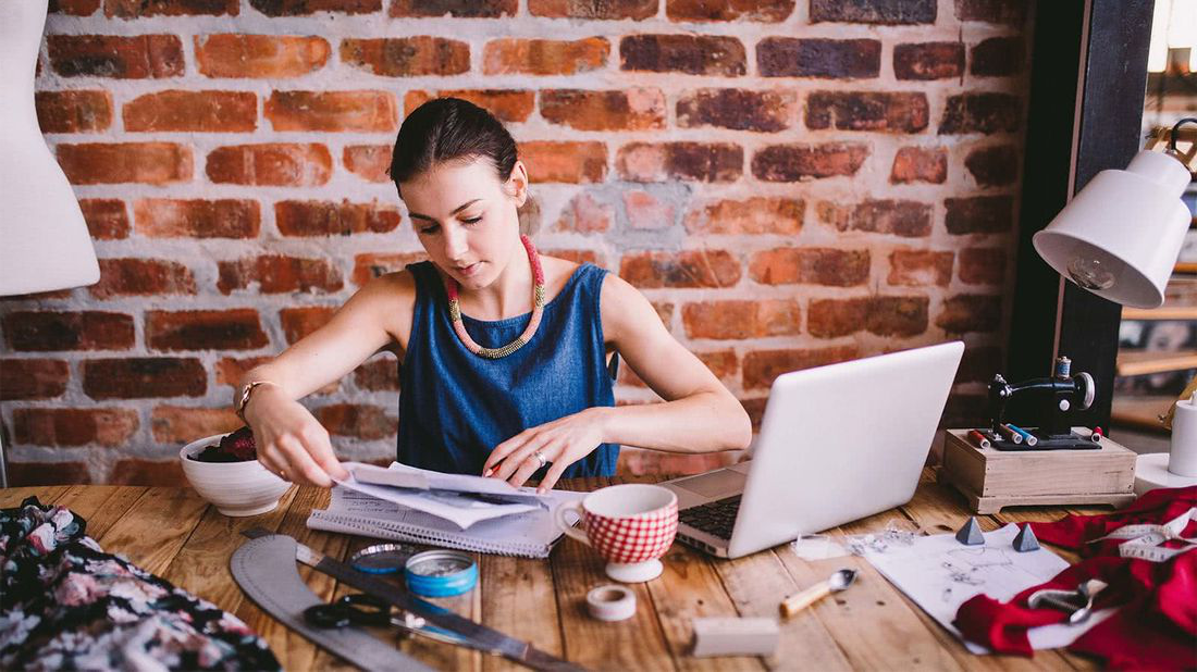 Woman at her desk researching how to start a small business