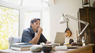 Man at desk researching reasons to consider a Roth 401k