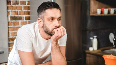 Man in kitchen wondering what to do when you lose your job