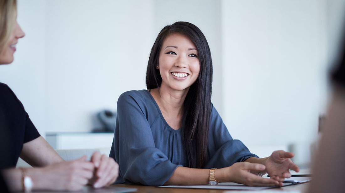 Woman at work after being noticed by recruiters on LinkedIn